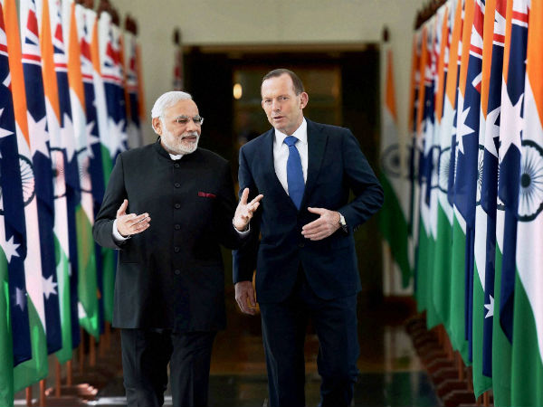 Prime Minister Narendra Modi with his Australian counterpart Tony Abbott leaves after addressing the Australian Parliament in Canberra, Australia on Tuesday. (PTI Photo by Kamal Singh)