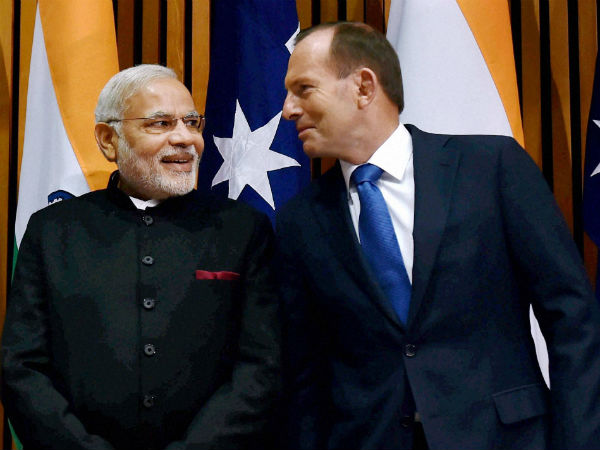 Canberra: Prime Minister Narendra Modi with his Australian counterpart Tony Abbott during signing of an MoU at Australian Parliament in Canberra, Australia on Tuesday. (PTI Photo by Kamal Singh)