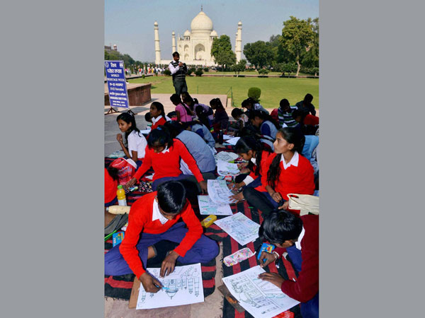 Children take part in a painting competition at Taj Mahal