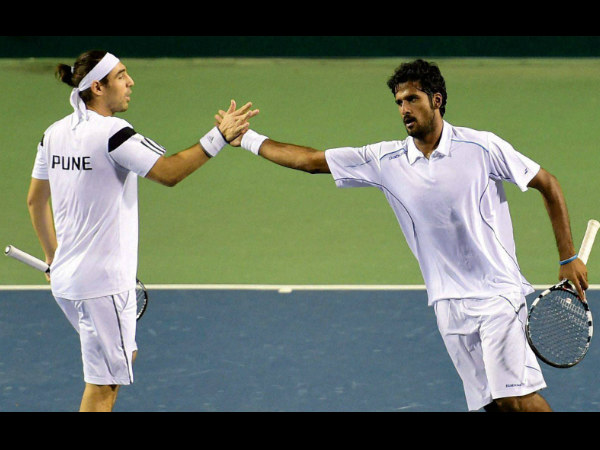 Marcos Baghdatis and Saketh Myneni of Pune Marathas celebrate a point against Feliciano Lopez and Ramkumar Ramanathan of Bangalore Raptors during the Men's Doubles match
