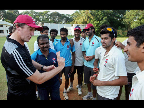 File photo of McGrath interacting with young cricketers