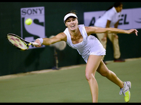 Hyderabad Aces' Martina Hingis in action against Venus Williams of Bangalore Raptors during women's singles match of Champions Tennis League