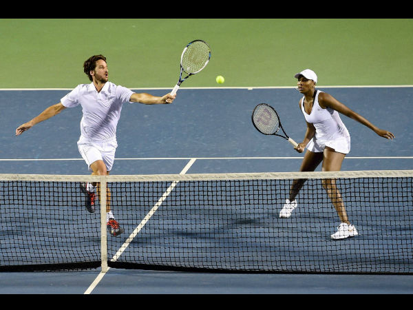 Bangalore Raptors' Venus Williams and Feliciano Lopez in action against Hyderabad Aces' Martina Hingis and Mikhail Youzhny during mixed doubles match