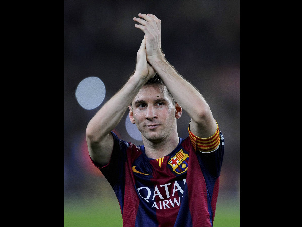 Barcelona's Lionel Messi, from Argentina, applauds at the end of the Spanish La Liga soccer match against Sevilla, at the Camp Nou stadium in Barcelona, Spain, Saturday.