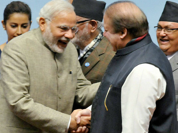 Prime Minister Narendra Modi shakes hands with his Pakistani counterpart Nawaz Sharif at the 18th SAARC Summit in Kathmandu, Nepal on Thursday. Nepal PM Sushil Koirala is also seen. (PTI Photo)