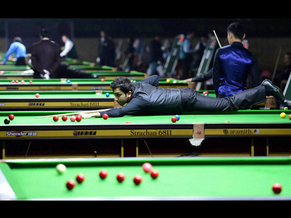 Pankaj Advani prepares to play a shot against Keen Hoo Moh of Malaysia during the IBSF World Snooker Championship in Bengaluru on Wednesday.