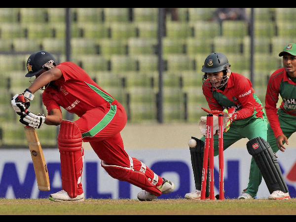 Tinashe Panyangara, left, is bowled out by Bangladesh's Taijul Islam. This was the 1st wicket of Taijul's hat-trick