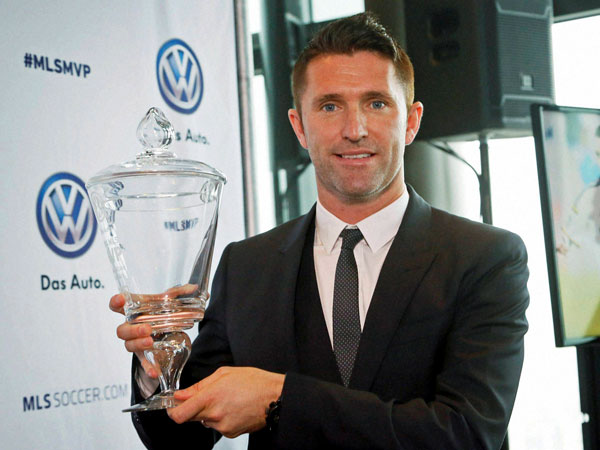 Robbie Keane with his trophy