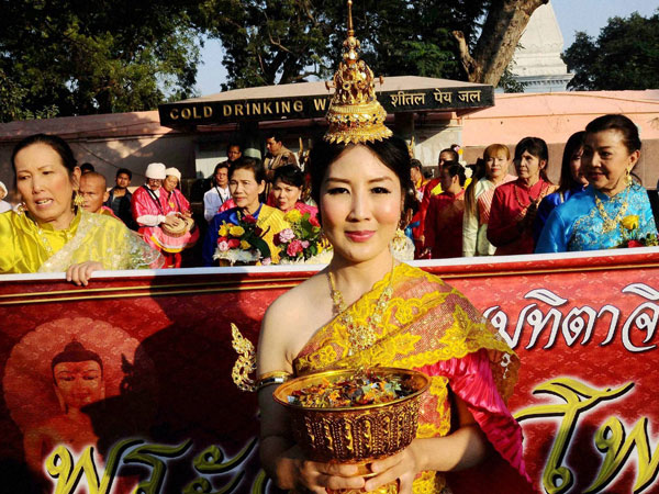 Devotees from Thailand take part in a procession