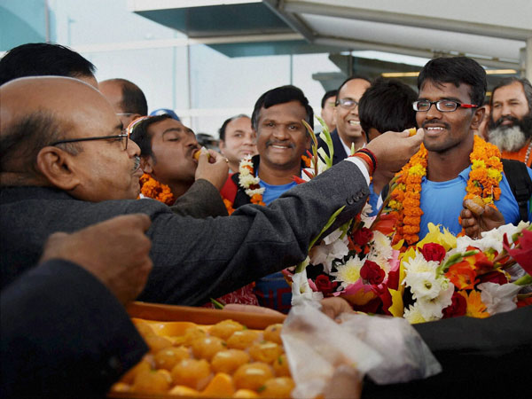 Indian blind cricket team being offered sweets