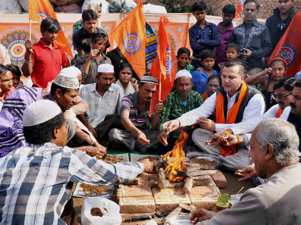 Members of Hindu organisations perform a ceremony for the conversion of Muslim families in Agra on Monday. (PTI Photo)