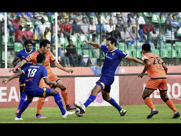 Players of Chennaiyin FC and Delhi Dynamos FC in action during their ISL match in Chennai on Tuesday.