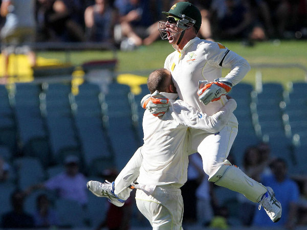Brad Haddin leaps into the arms of teammate Nathan Lyon as they celebrate after defeating India by 48 runs