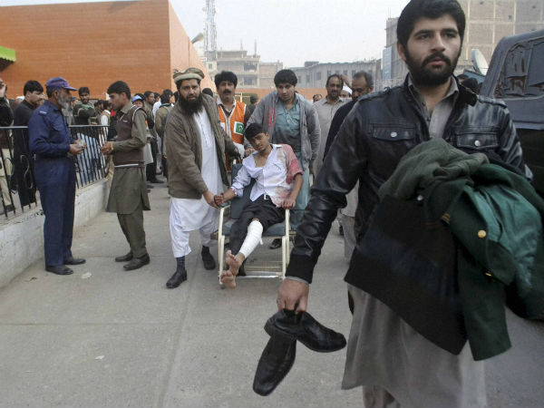 A Pakistani student, who was injured in a Taliban attack in a school, is brought to a hospital in Peshawar.