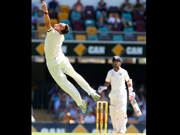 Josh Hazelwood is airborne as he attempts to take a catch off Ajinkya Rahane, right