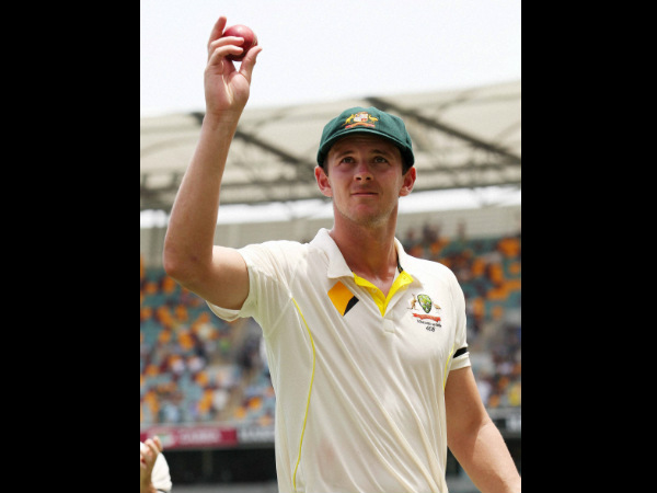 Josh Hazlewood holds the ball aloft after taking five wickets on debut