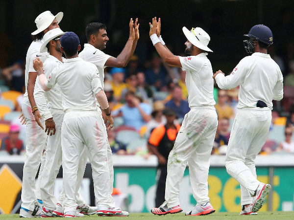 Ashwin is congratulated by teammates after taking the wicket of Watson