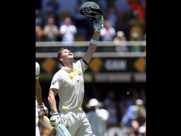 Steve Smith reacts after reaching his century
