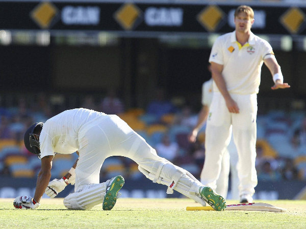Watson (right) apologises after his throw hit Shikhar (on the ground)