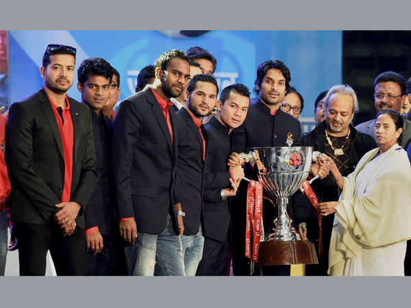 West Bengal Chief Minister Mamata Banerjee with the players of Atletico de Kolkata during a felicitation ceremony, in Kolkata on Wednesday.