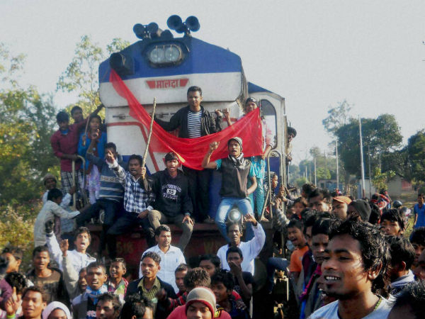 Activist of All Assam tea tribe student association stop a train at Salina Railway Station in Nagaon Dist during the 12 hr Assam Bandh called by different Adivasi Organization against the Bodo militant attacks, on Friday.