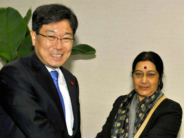 External Affairs Minister Sushma Swaraj shakes hand with Yoon Sang-jick, South Korea's Minister of Trade, Industry and Energy, in Seoul on Sunday.