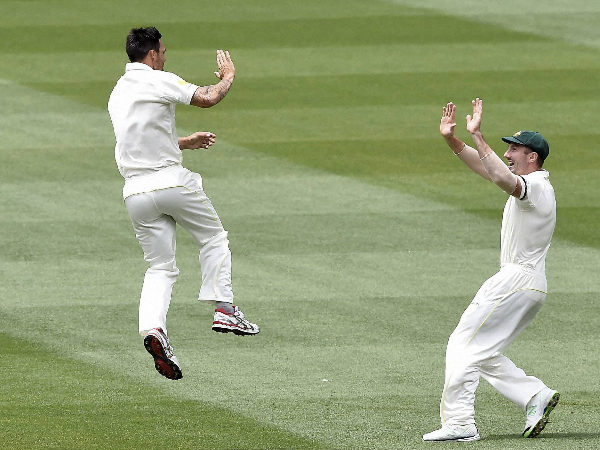 Mitchell Johnson (left) celebrates with Shaun Marsh after dismissing KL Rahul