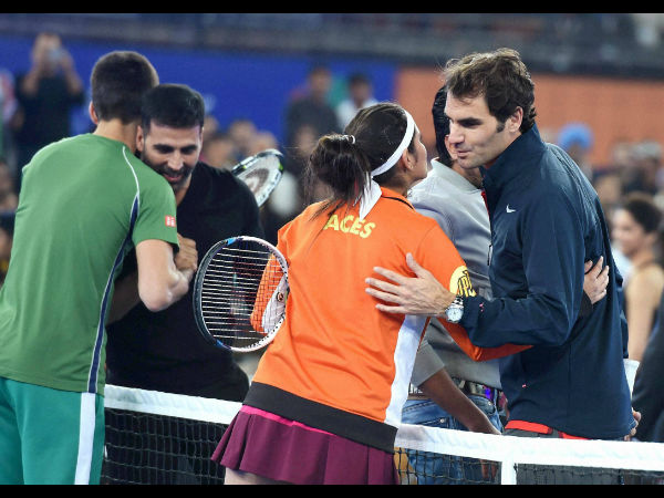 File photo: Foreground - Sania (left) and Federer during the International Tennis Premier League in India