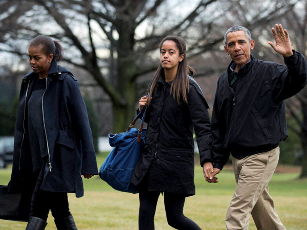 Barack Obama returns from vacation