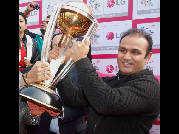 Sehwag holds the World Cup trophy at an event in Gurgaon on Friday