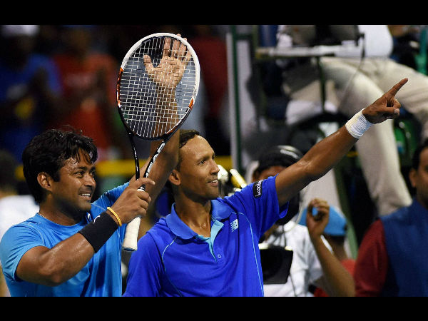 Paes and Klaasen celebrate their win