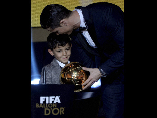 Cristiano Ronaldo (right) of Portugal kisses his son Cristiano Jr. who holds the throphy after winning the FIFA Men's soccer player of the year 2014 prize at the FIFA Ballon d'Or awarding ceremony