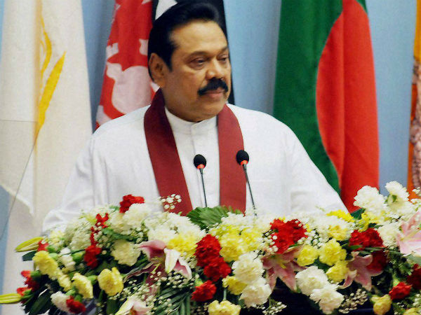 Rajapaksa agrees to step down as party boss.