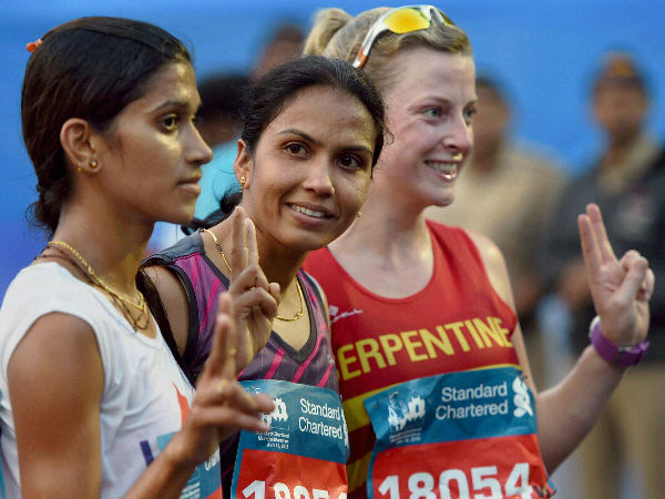 From left: Supriya Patil, Kavita Raout and Eve Bugler flash victory signs after winning the marathon