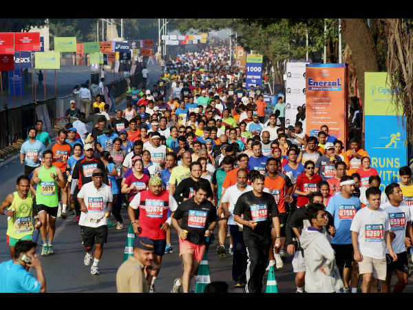 People participate in Standard Chartered marathon in Mumbai on Sunday.