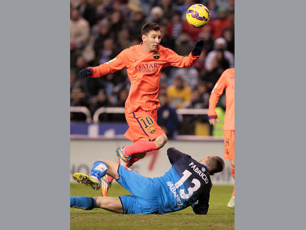 Messi in action against Deportivo La Coruna