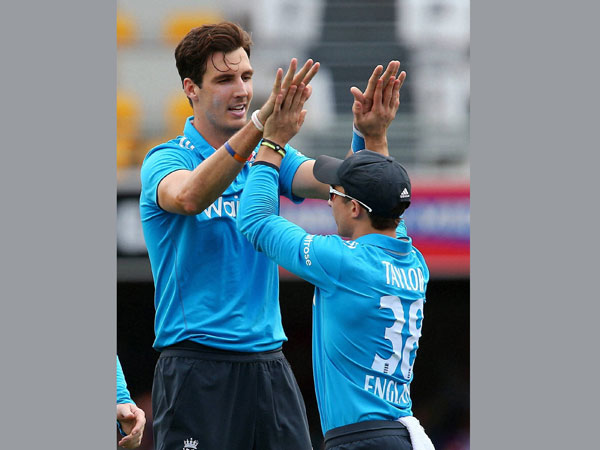 Steven Finn (left) celebrating one of his wickets