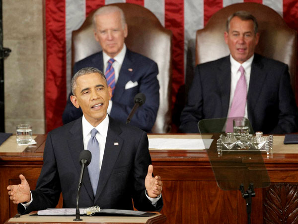 Defiant Obama bats for middle class