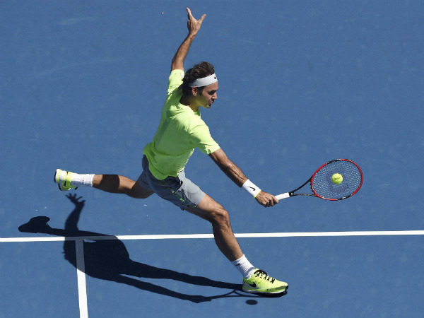 Federer makes a backhand return to Seppi during their third round match