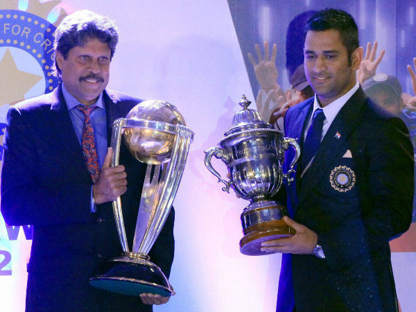 India's World Cup winning captains Kapil Dev and MS Dhoni with the trophies