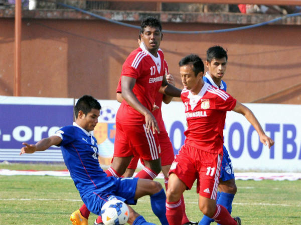 Pune FC players in action against Bengaluru FC in a round two match of the I-League football tournament