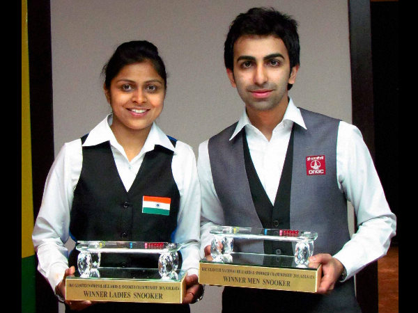 Pankaj Advani (right) and Amee Kamani pose with their trophies