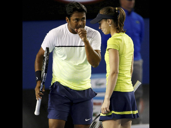 Hingis, right, and Paes talk during their match against Andrea Hlavackova and Alexander Peya at the Australian Open
