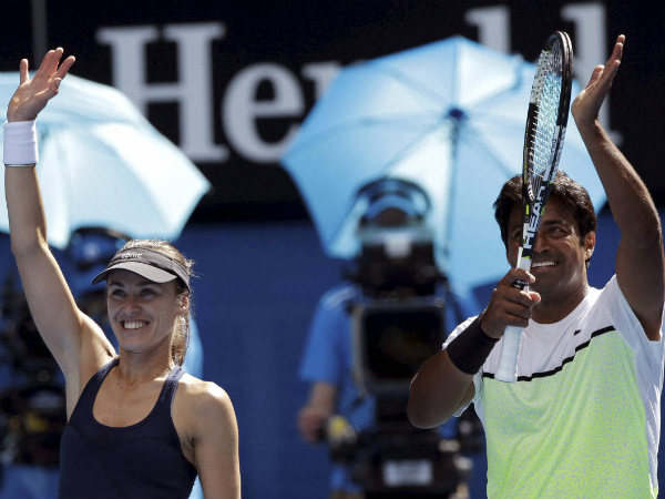 Martina Hingis of Switzerland (left) along with Leander Paes of India cruise into Australian Open mixed doubles final