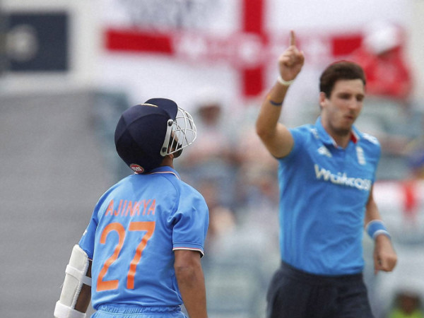 Rahane, left, reacts after being caught behind for 73 runs off the bowling of Finn, right