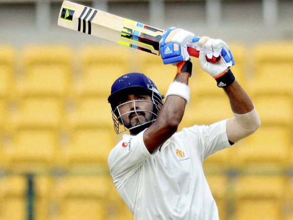 Rahul plays a shot en route to his record 337