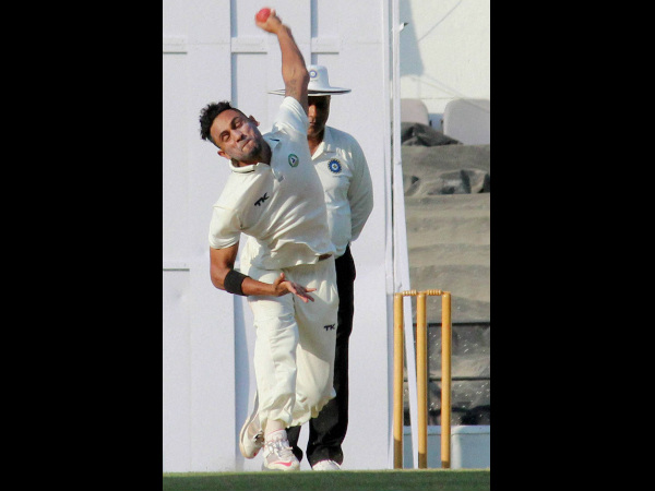 Shrikant Wagh bowls during the match. He took 3 wickets in 2nd innings