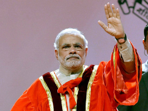 Prime Minister Narendra Modi waves during the 102nd Indian Science Congress 2015 at University of Mumbai on Saturday. (PTI Photo)