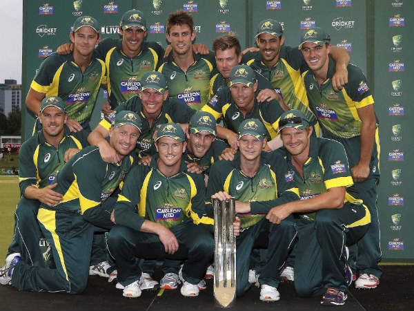 The Australian Team pose for a photo with the trophy after defeating England in the tri-series