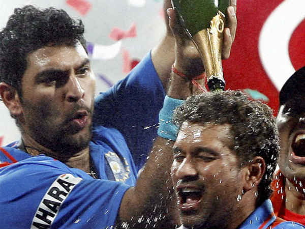Yuvraj pours champagne on Sachin's head as they celebrate 2011 World Cup win